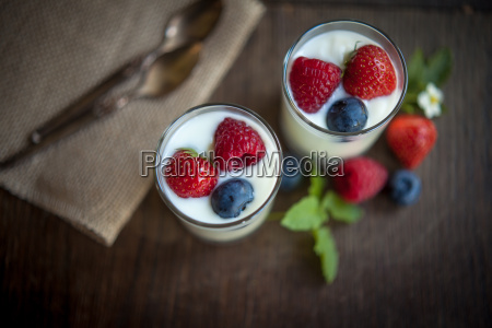 natural yogurt glasses with fresh berries