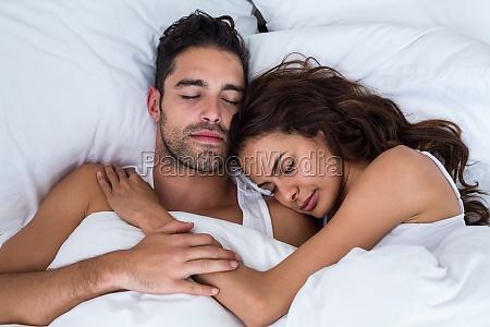 close up of couple sleeping on
