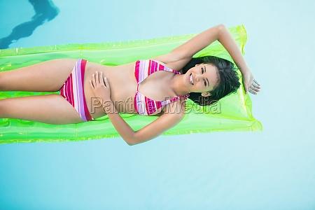 happy woman in bikini lying on