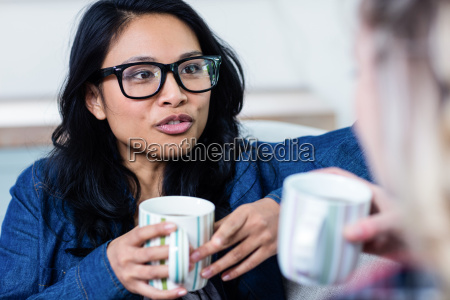 woman talking with female friend while