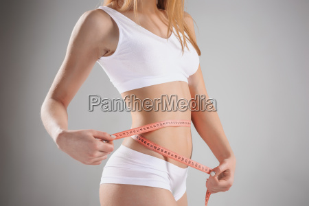 woman holding meter measuring perfect shape