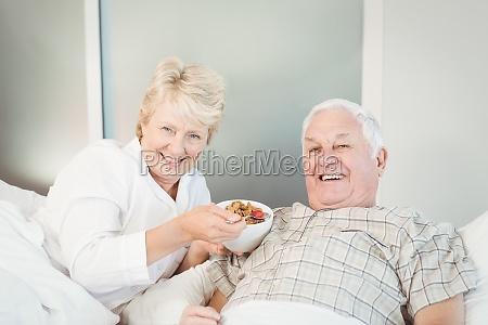 happy senior couple having breakfast in