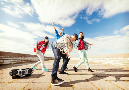 group of teenagers dancing