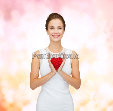 smiling woman in white dress with