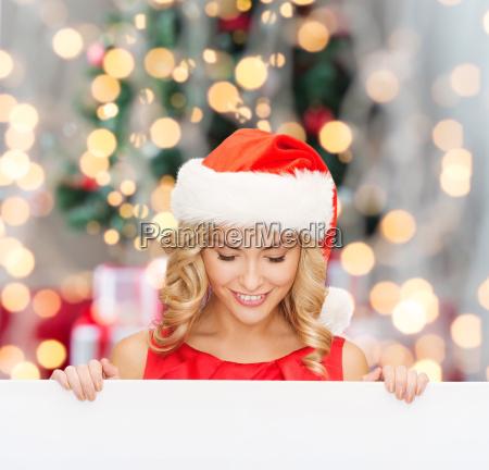 woman in santa helper hat with