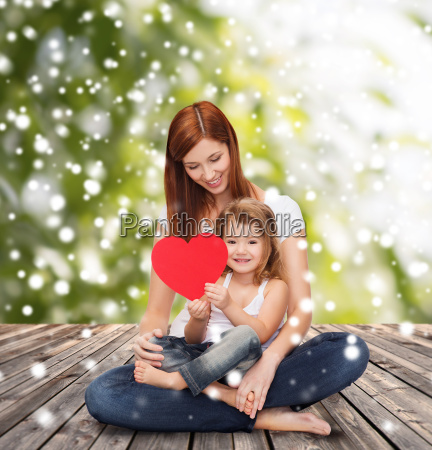 happy mother with adorable little girl