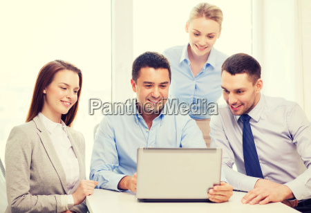 business team working with laptop in