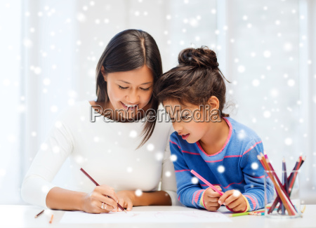 mother and daughter with coloring pencils