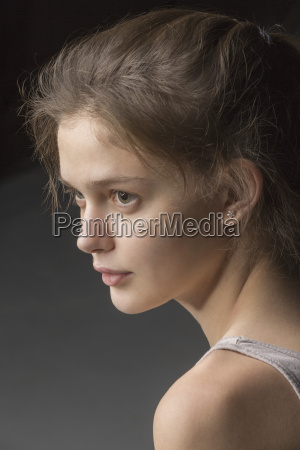 close up of thoughtful young woman
