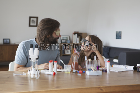 father and daughter doing science experiment