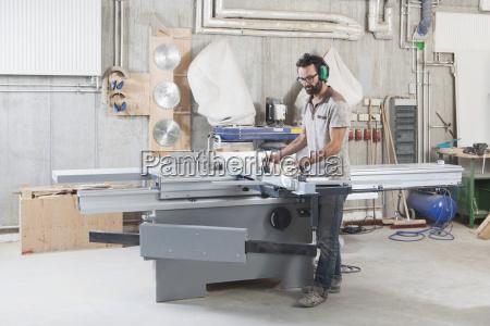 full length of carpenter using a