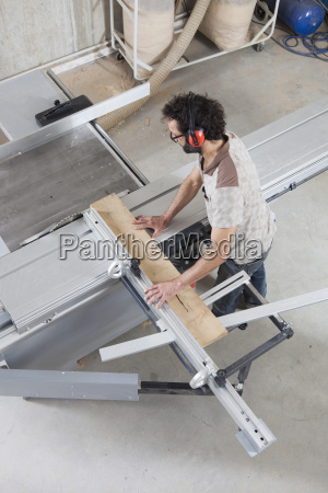 high angle view of carpenter using