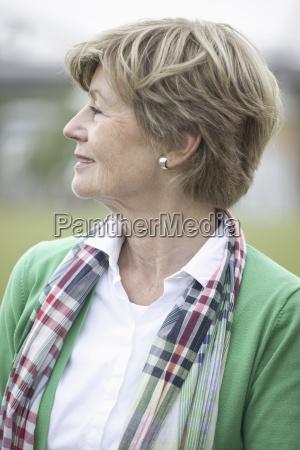 mature woman looking away close up