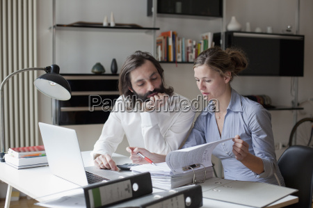 mid adult couple working at home