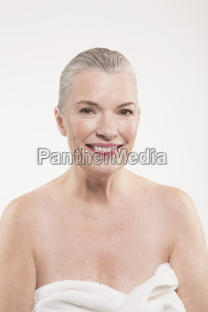 portrait of happy mature woman wrapped
