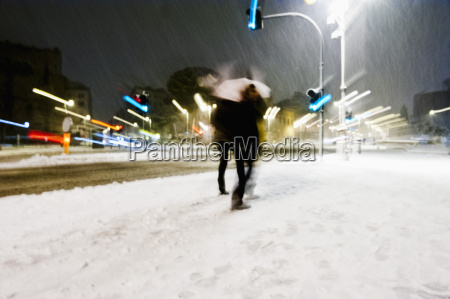 people walking in city during snow