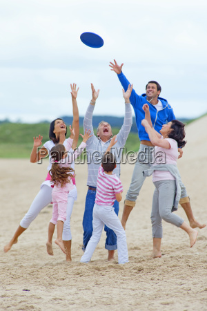 multi generation family throwing plastic disc