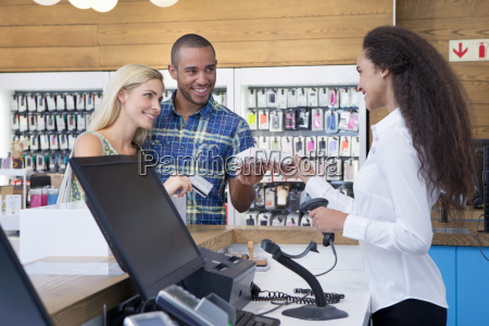 couple making a purchase from store