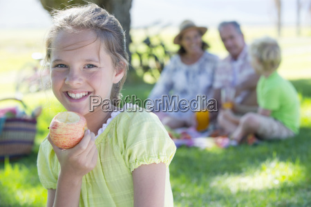 portrait of girl eating apple with