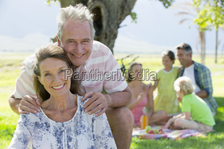 senior couple and multi generation family