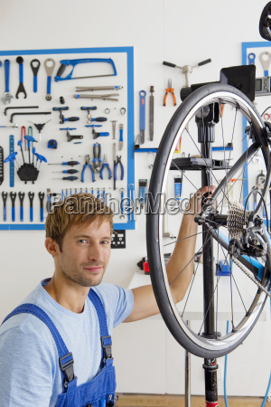 cycle technician looking at camera in