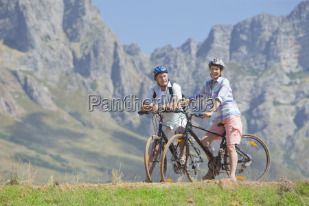 couple cycling on mountain track