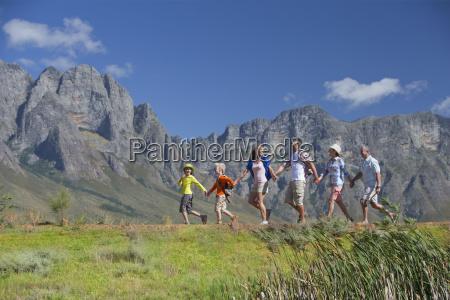 multi generation family hiking on mountain