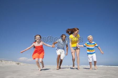happy family running toward camera holding