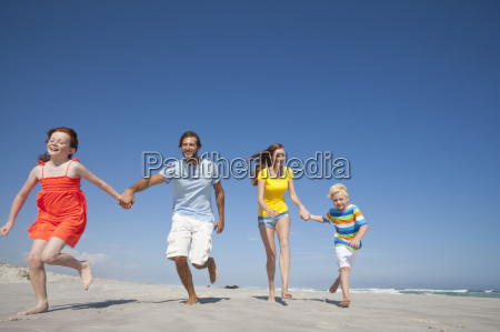 happy family running toward camera holding
