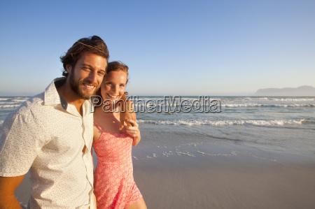 smiling couple looking at camera man