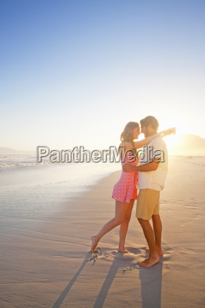 romantic couple embracing looking into each