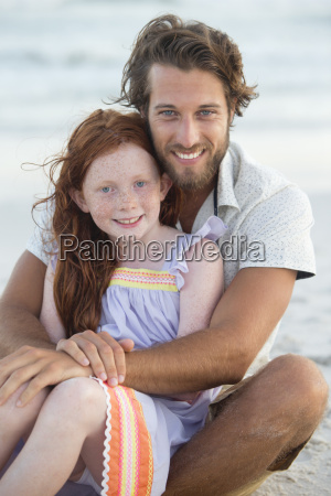 portrait of father and daughter smiling