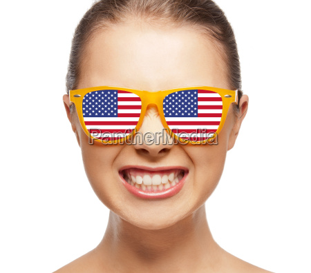 happy teenage girl in shades with