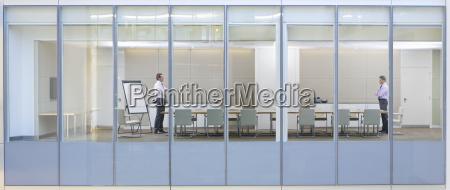 view through window of business men