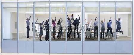view through window of people jumping