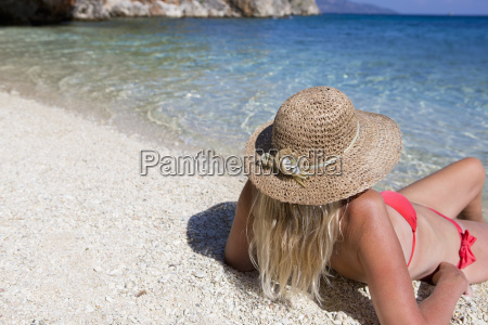 woman looking out to sea lying