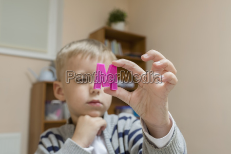 close up of boy holding letter