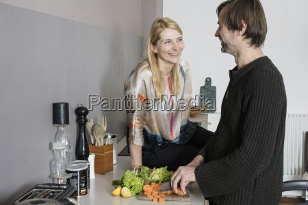 smiling mature woman looking at man