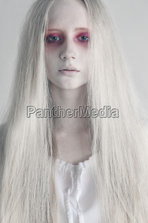 young woman with spooky red eyes