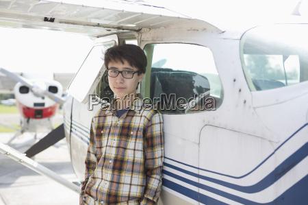 portrait of confident teenage boy standing