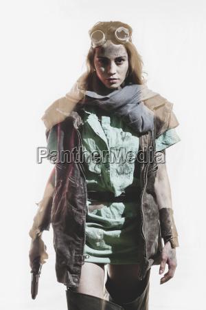 young woman wearing jacket holding gun