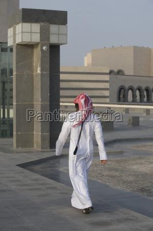 rear view of arab man walking