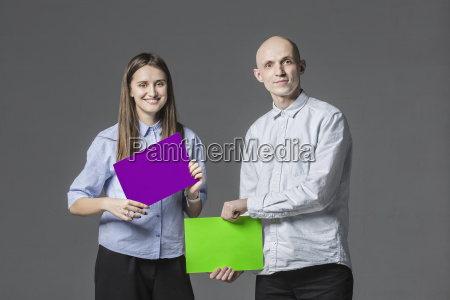 portrait of business people holding placards