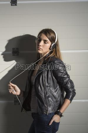 relaxed woman listening music through headphones