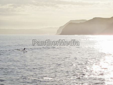 man on stand up paddleboard on