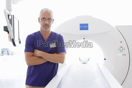 portrait serious doctor at ct scanner