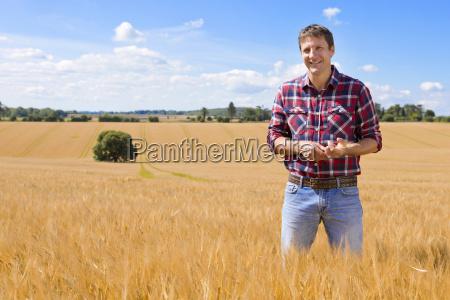 portrait confident farmer in sunny rural