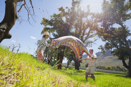 senior couple laying picnic blanket in