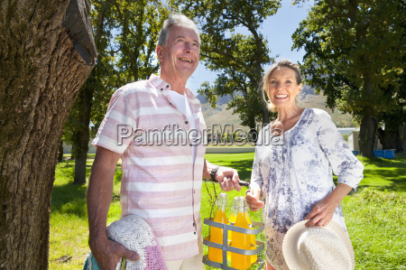 senior couple with picnic bottles in