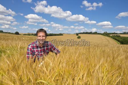 portrait smiling farmer in sunny rural